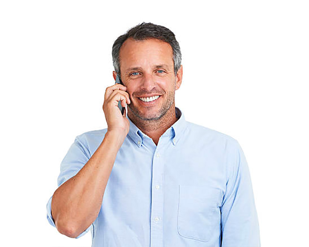 Gentleman with phone up to ear smiling.